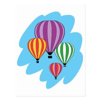 Cuatro globos coloridos del aire caliente postales