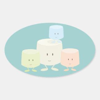 Cuatro melcochas que sonríen junto colcomanias oval