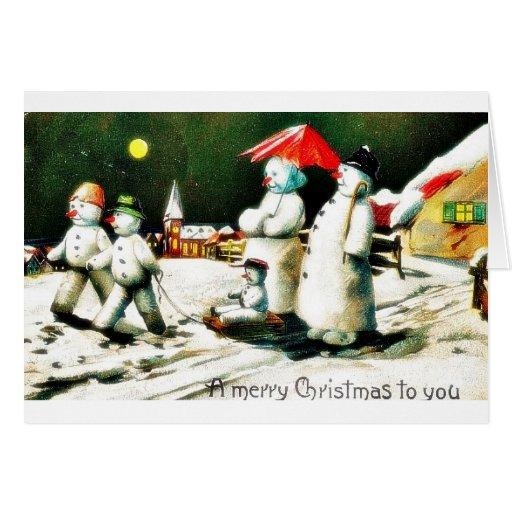 Cuatro muñecos de nieve que llevan a un niño felicitacion