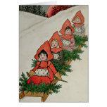 Cuatro niñas en un trineo tarjeta de felicitación