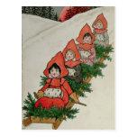Cuatro niñas en un trineo tarjeta postal