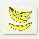 Cuatro plátanos amarillos alfombrillas de ratones