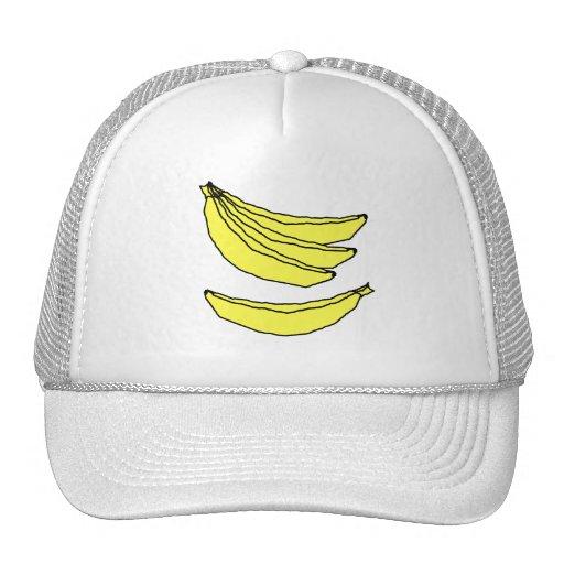Cuatro plátanos amarillos gorros bordados