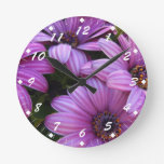 Cuatro rayaron margaritas púrpuras reloj de pared