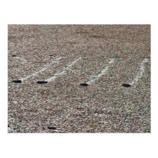 Cuatro rocas en pistas del fango de Playa Tarjeta Postal