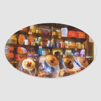 Cuatro tarros de cristal del caramelo pegatina ovalada