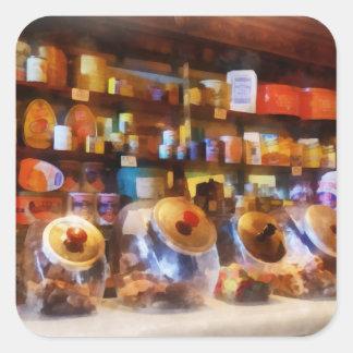Cuatro tarros de cristal del caramelo pegatina cuadrada