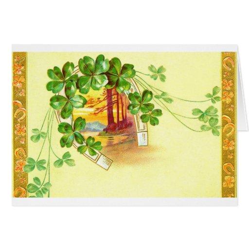 Cuatro trébol y herradura con hojas tarjeta