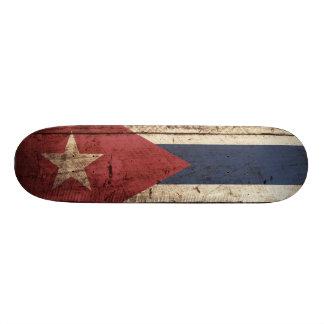 Cuba Flag on Old Wood Grain Skateboard Deck