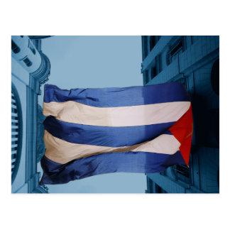 Cuban flag between buildings in Havana, Cuba Postcard