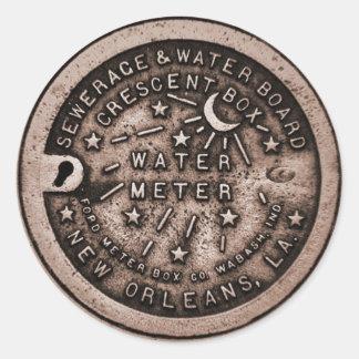 Cubierta del contador del agua de New Orleans Etiqueta