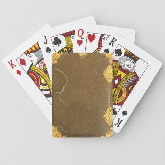 Cubierta del oro y de libro viejo barajas de cartas