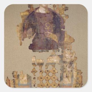 Cubierta que representa a una mujer que lleva a pegatina cuadrada