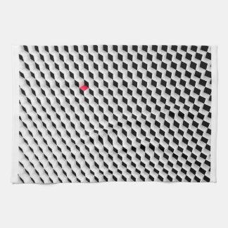 Cubos blancos y negros con un cubo rojo toallas