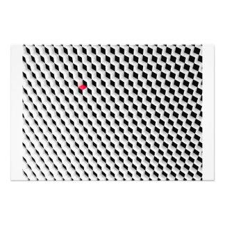 Cubos blancos y negros con un cubo rojo fotos