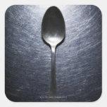 Cuchara del metal en el acero inoxidable pegatina cuadrada