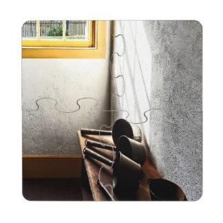 Cucharones en banco posavasos de puzzle