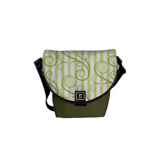 Cucumber slices and flower with green stripes messenger bag