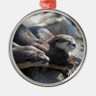 Cuddling Otters Round Metal Christmas Ornament