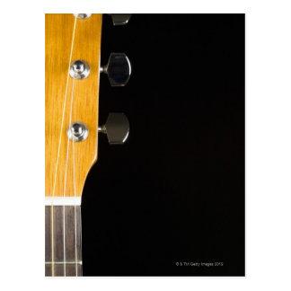 Cuello y cabeza de la guitarra tarjeta postal