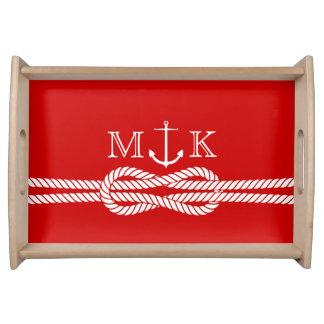 Cuerda y monograma náuticos del ancla en rojo bandejas