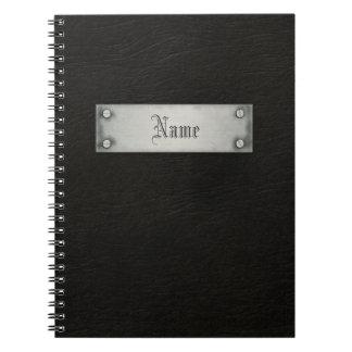 Cuero negro con la placa spiral notebooks