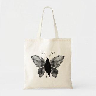 Cuervo negro y blanco de la mariposa bolsas