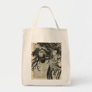 Cuervo y niño en un viejo ejemplo del vintage del bolsa tela para la compra
