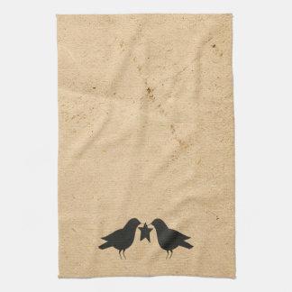 Cuervos con la toalla de cocina de la estrella