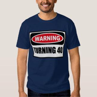 Cuidado DANDO VUELTA a la camiseta oscura de 40 Remeras