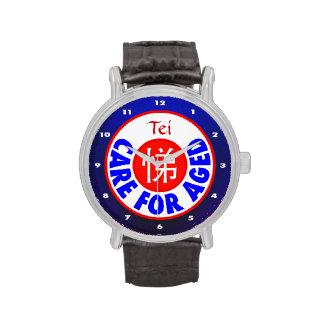 Cuidado para envejecido - monograma de Tei Reloj