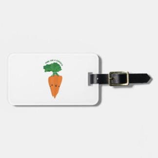 Cuidado para una zanahoria etiquetas maleta