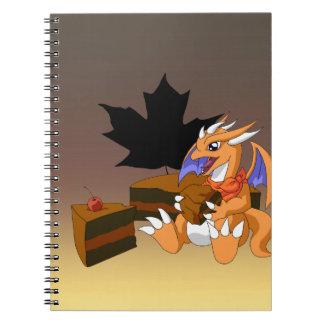 Cumpleaños del dragón con el cuaderno de la torta