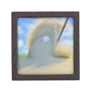 cuña de arena que golpea una pelota de golf fuera  caja de regalo de calidad
