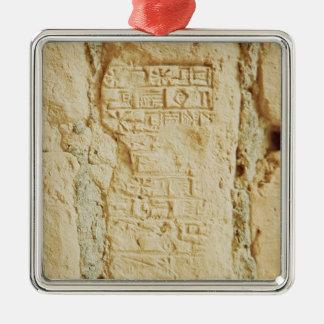 Cuneiform script on a palace wall metal ornament
