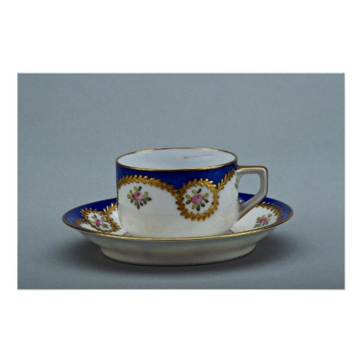 Cup and saucer with colorful designs posters