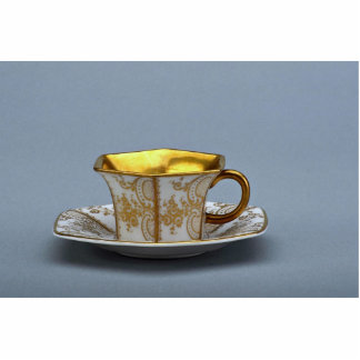 Cup and saucer with colorful designs standing photo sculpture