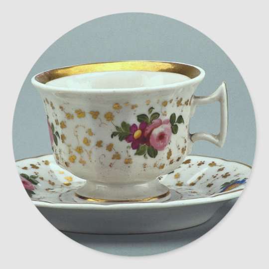 Cup and saucer with colorful flower designs on it. classic round sticker
