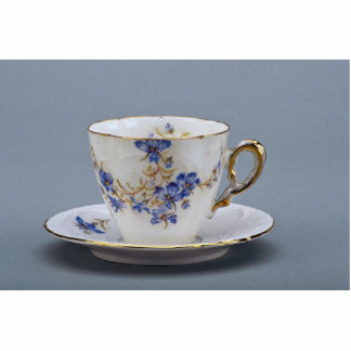 Cup and saucer with colorful flower designs standing photo sculpture