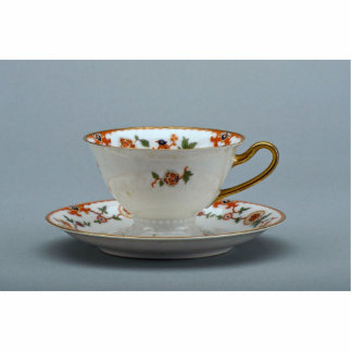 Cup and saucer with colorful flowers on it. standing photo sculpture