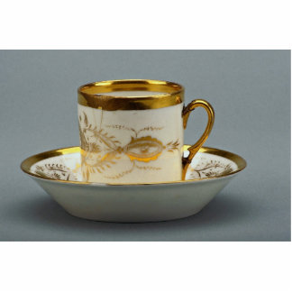 Cup and saucer with creative designs standing photo sculpture