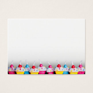 Cup cake candles on bottom edge business card
