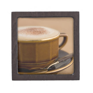 Cup of cappuccino with cocoa powder jewelry box