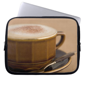 Cup of cappuccino with cocoa powder laptop sleeve