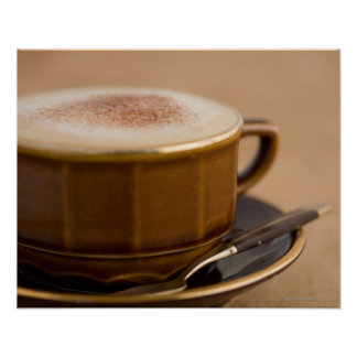 Cup of cappuccino with cocoa powder posters
