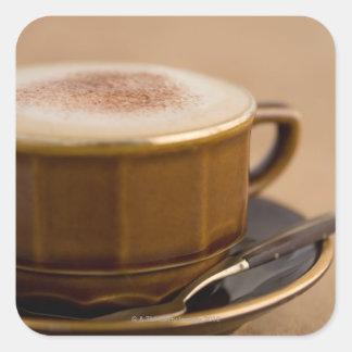 Cup of cappuccino with cocoa powder square sticker
