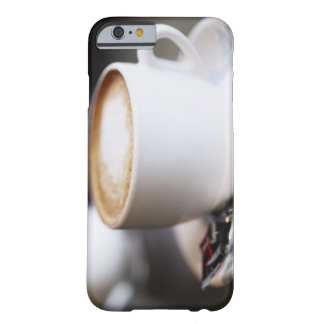 cup of coffee latte on table, close-up barely there iPhone 6 case