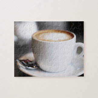 cup of coffee latte on table, close-up jigsaw puzzle