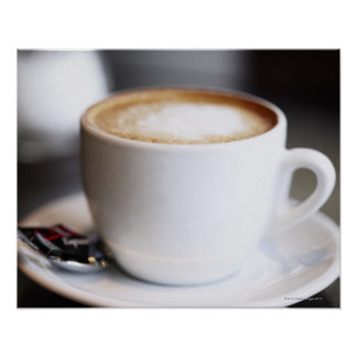 cup of coffee latte on table, close-up print