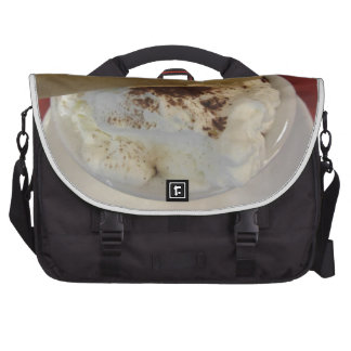 Cup of hot chocolate with whipped cream topping laptop computer bag